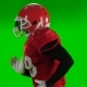 Football Player Running Red Uniform and Helmet. Green Screen,