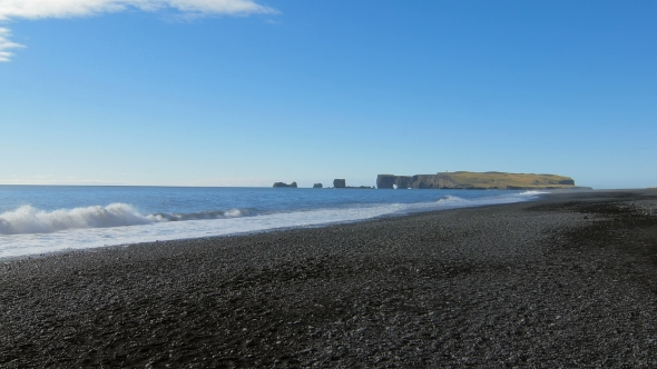 VideoHive View of Cape Dyrholaey From Black Sand Beach in Iceland in Sunny Calm Weather 18930291