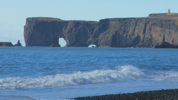 VideoHive Cape Dyrholaey From Black Sand Beach in Iceland in Sunny Calm Weather 18930439