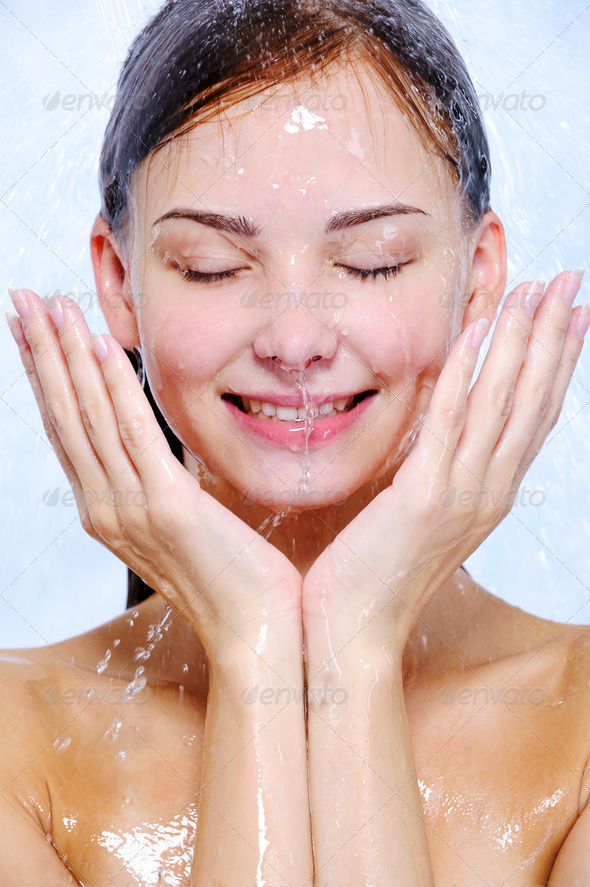 splashes and drops of water on the  female face - Stock Photo - Images