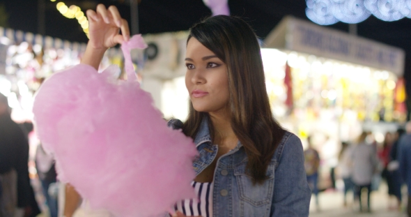 Download Laughing Young Woman Eating Pink Candy Floss nulled download