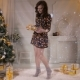 Young Attractive Woman Put Gifts Under the Christmas Tree. Christmas Celebration Concept.