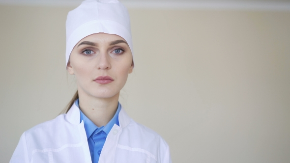 VideoHive Portrait of a Young Adult Female Doctor Looking at Camera 18943756