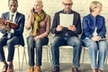 Diverse Group of People Community Sitting Waiting Concept