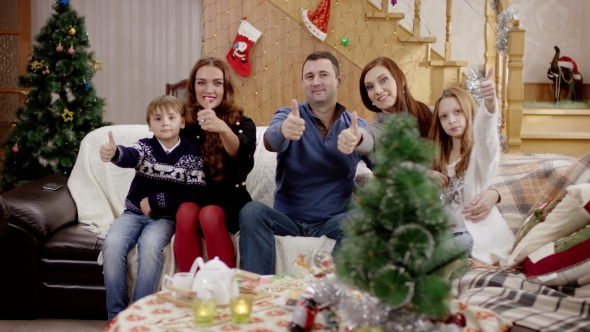 Family Showing Thumb Up at Christmas Party