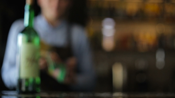 VideoHive The Bartender Pours Wine Into a Glass 18949932