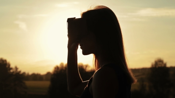 VideoHive Woman Uses a Virtual Reality Glasses in the Forest at Sunset 18950074