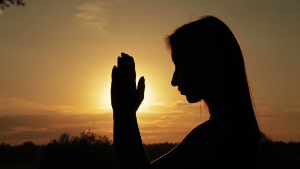 VideoHive Young Woman Praying in the Forest at Sunset 18950103