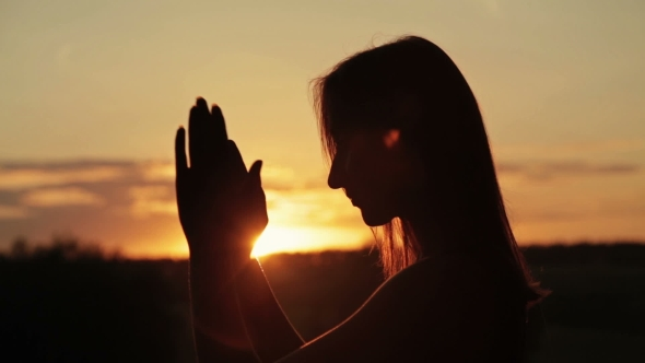 VideoHive Young Woman Praying in the Forest at Sunset 18950119