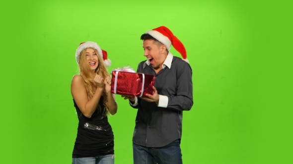 VideoHive Young Man Giving a Christmas Present To His Surprised Girlfriend Green Screen 18951701