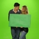 Energetic and  Beautiful Couple Holding Up a Blank Sign, Green Screen