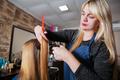 Professional hairdresser cutting hair