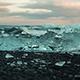 Small Icebergs On The Black Volcanic Sand Beach