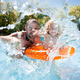 Download Child with father in swimming pool from PhotoDune