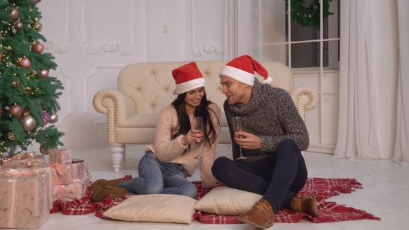 VideoHive Woman and Man Cheers Wine at Winter Holiday 18959951
