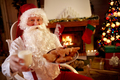 Santa Claus in his wooden home