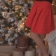 Young Beautiful Woman the Christmas Tree in Nice Decorating House