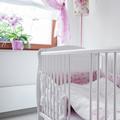 White crib in nursery room