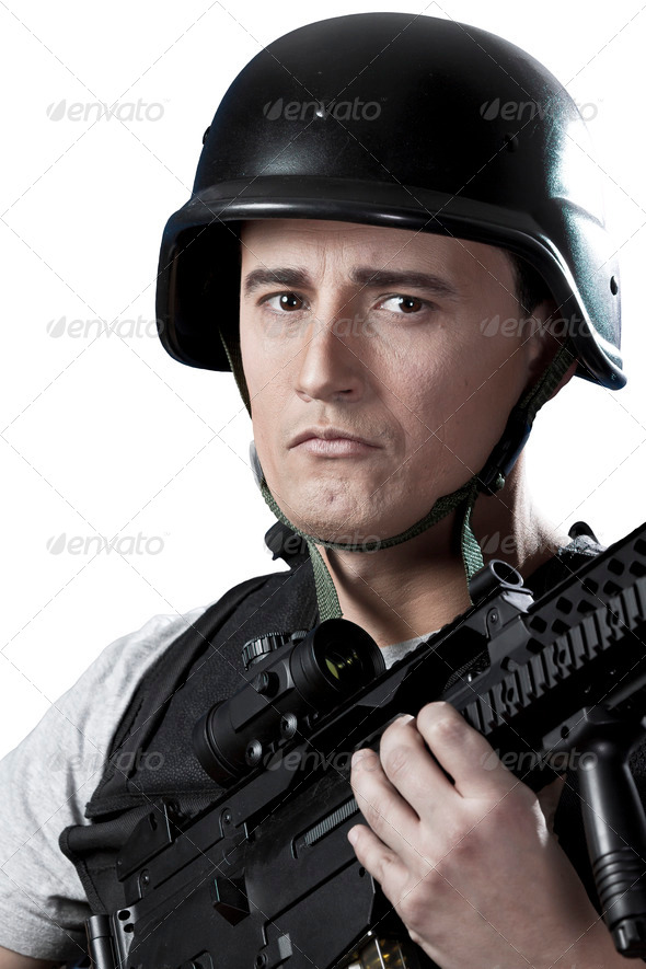 Armed military in protective cask with a weapon - Stock Photo - Images