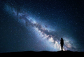 Milky Way with standing woman. Night landscape