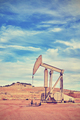 Vintage toned picture of an old oil pump.