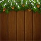 Christmas Fir Tree Branches with Snow and Pinecones on Wooden Background