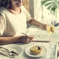 Young Woman Writing Diary Concept