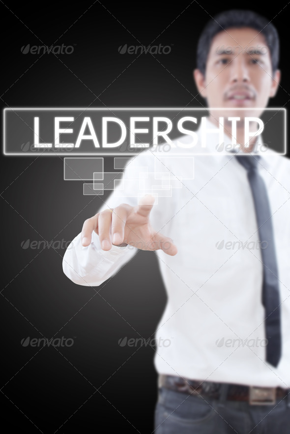 Businessman pushing Leadership word. - Stock Photo - Images