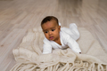 Adorable little african american baby boy looking - Black people
