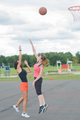 players practising netball in playground
