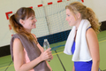 Two women chatting in sports hall
