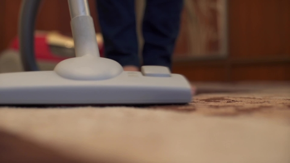 VideoHive Woman Using Vacuum Cleaner on Rug at Home in the Living Room 19002238