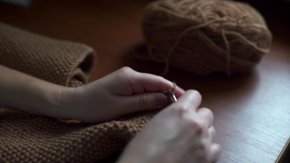VideoHive of Young Woman Knitting 19002248