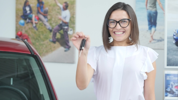 VideoHive Young Happy Woman Near the Car with Keys in Hand 19012934
