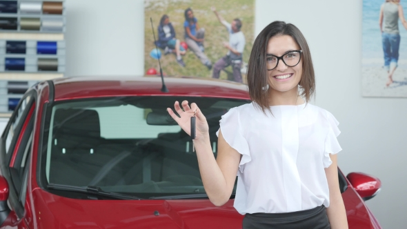 VideoHive Young Happy Woman Near the Car with Keys in Hand 19012962