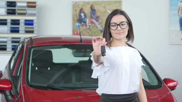 VideoHive Young Happy Woman Near the Car with Keys in Hand Concept of Buying Car 19012980