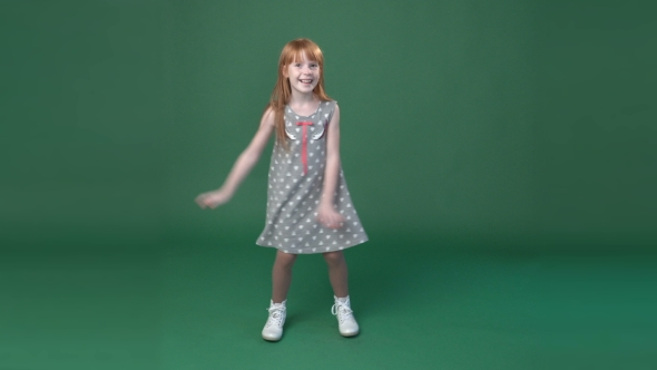 VideoHive Cute Little Ginger Girl Dancing and Fooling Around 19017652