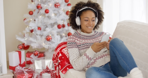Download Attractive Woman Listening To Music at Christmas nulled download