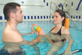 pregnant female and husband at the swimming pool