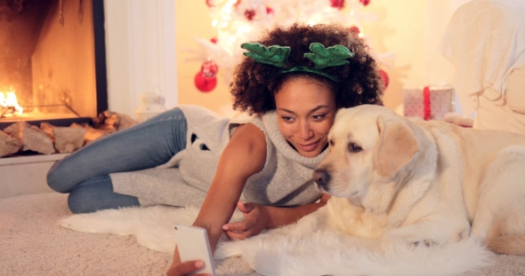 Download Cute Young Woman Taking a Selfie with Her Dog nulled download