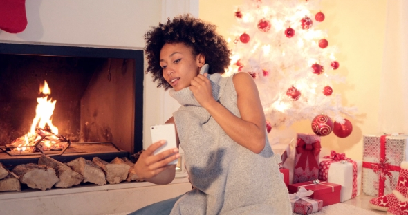Download Stylish Young Woman Taking a Christmas Selfie nulled download