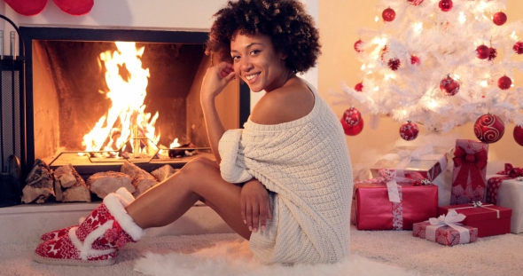 Download Cute Young Woman Warming Herself at the Fire nulled download