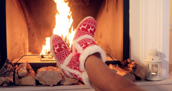 Download Young Woman Relaxing in Christmas Booties nulled download