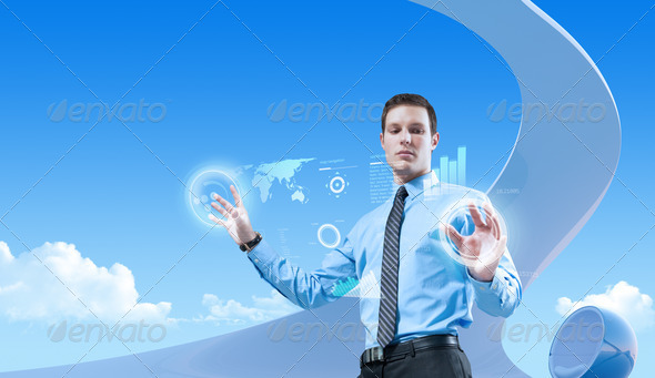 Young handsome businessman using futuristic hologram interface in the bio style interior - Stock Photo - Images