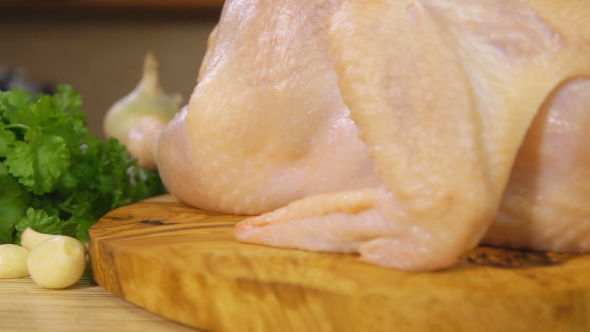 VideoHive Raw Chicken on a Wooden Cutting Board Sprinkled with Spices 19052992