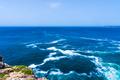 Ocean wave background. Cliff coastline in Sagres, Algarve, Portu