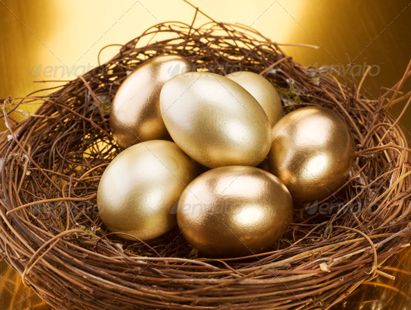 Golden Nest Eggs - Stock Photo - Images