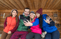 People Group Taking Selfie Photo Smart Phone Wooden Country House Terrace Winter Mountain Resort