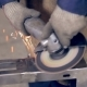 Worker Using Industrial Grinder on Metal Parts in Industrial Plant, Factory.