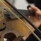 Musician Playing at Violin